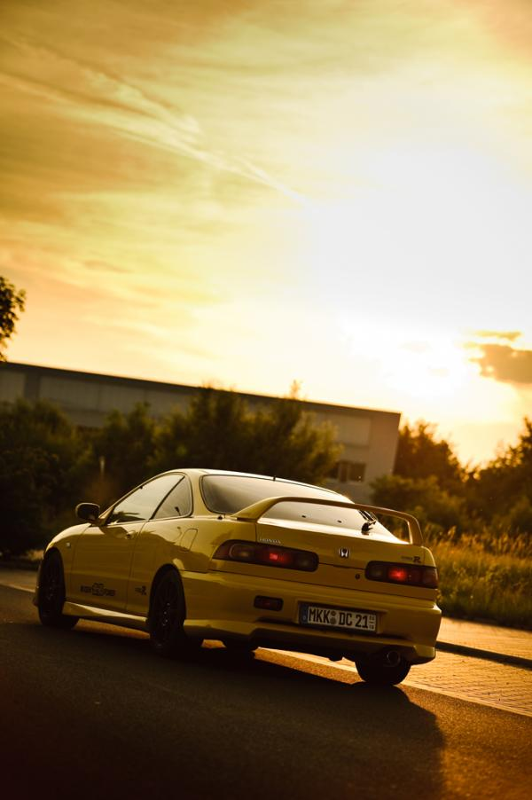 Yellow Integra Type-R at sunset