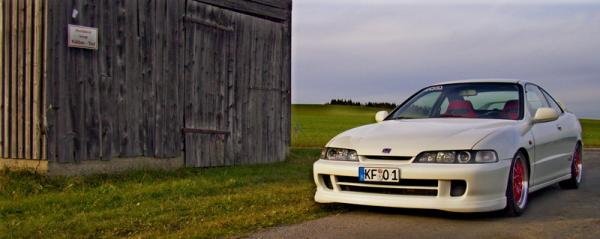 EDM Integra Type-R next to a barn jdm front end