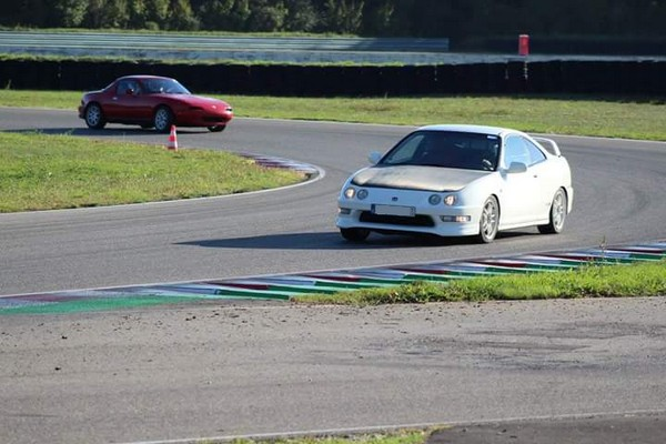 1998 Championship White EDM Integra Type-R cornering at the track