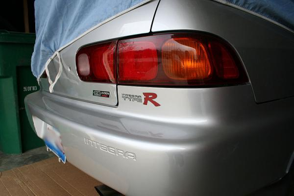 Vogue Silver Metallic 1997 JDM Integra Type-R safely in the garage
