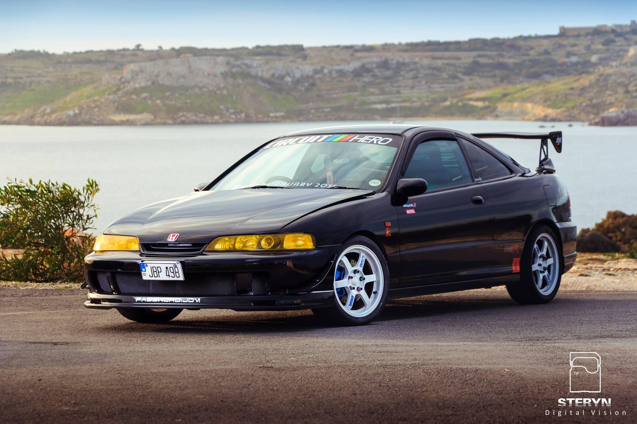 Starlight Black Pearl 1998 JDM Honda Integra Type-r in front of scenic water