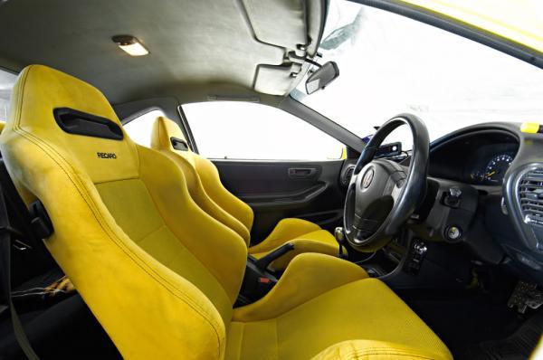Australian ITR Yellow Recaros and yellow stitched rear black seats
