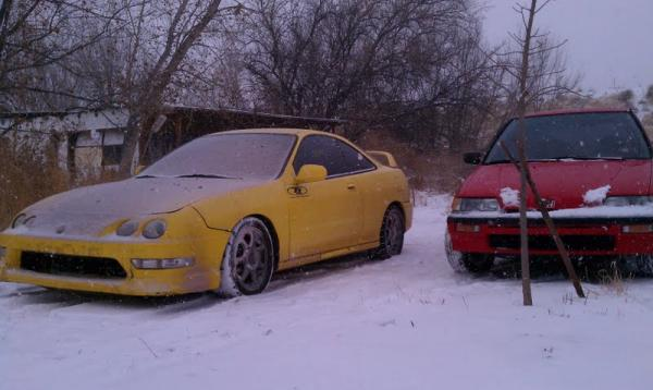 Phoenix Yellow Acura Integra Type-R getting snowed on