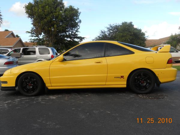 Phoenix Yellow ITR with OEM black wheels