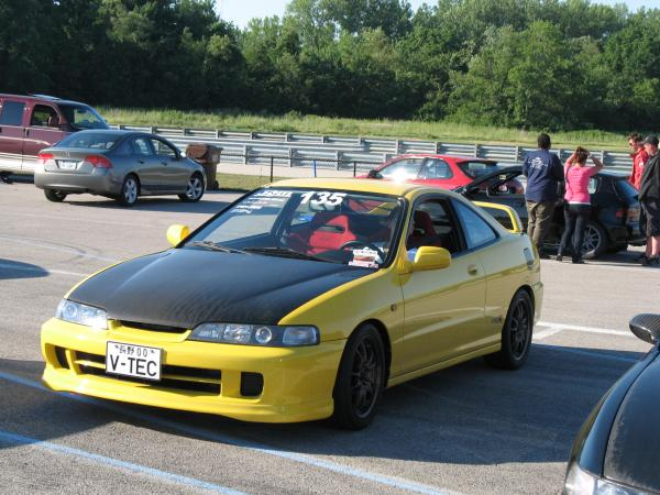 Phoenix Yellow ITR with JDM front end and JDM Red Recaro seats