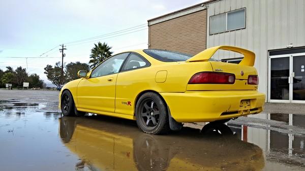 2000 Phoenix Yellow Acura Integra Type-R in puddle
