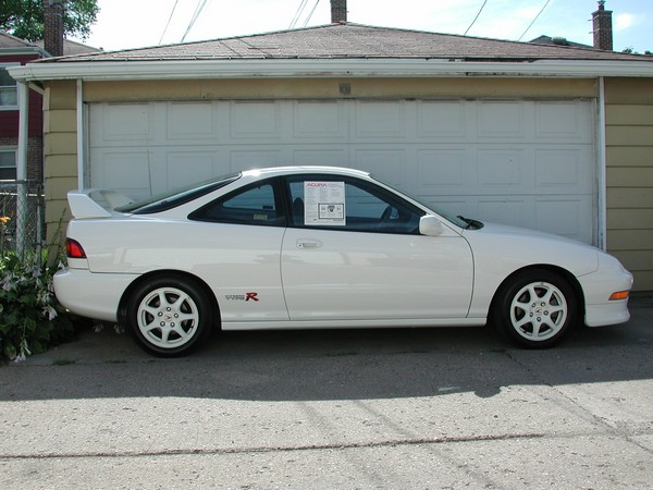 championship white 1997 Acura Integra Type-R with window sticker