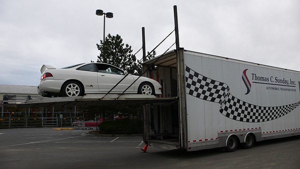 championship white 1997 Acura Integra Type-R loaded on a transport trailer
