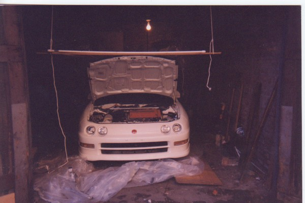 championship white 1997 Acura Integra Type-R in garage