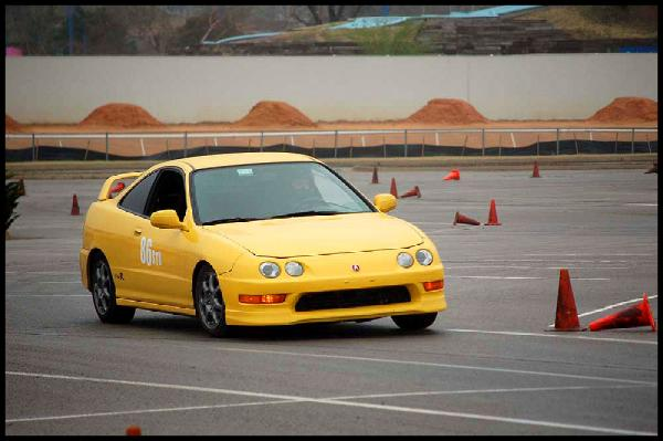 2001 Phoenix yellow Integra Type-r racing around cones