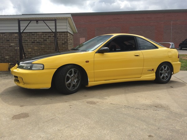 2001 Phoenix Yellow ITR with JDM front and black spoiler
