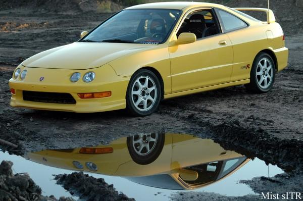 01' PY ITR next to a puddle