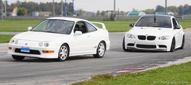 Stock 1998 Championship White USDM Acura Integra Type-R at track