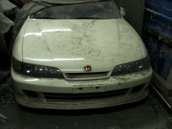 1998 championship white Acura Integra Type R with JDM front end in storage