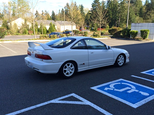 1998 Championship White Acura ITR passenger side